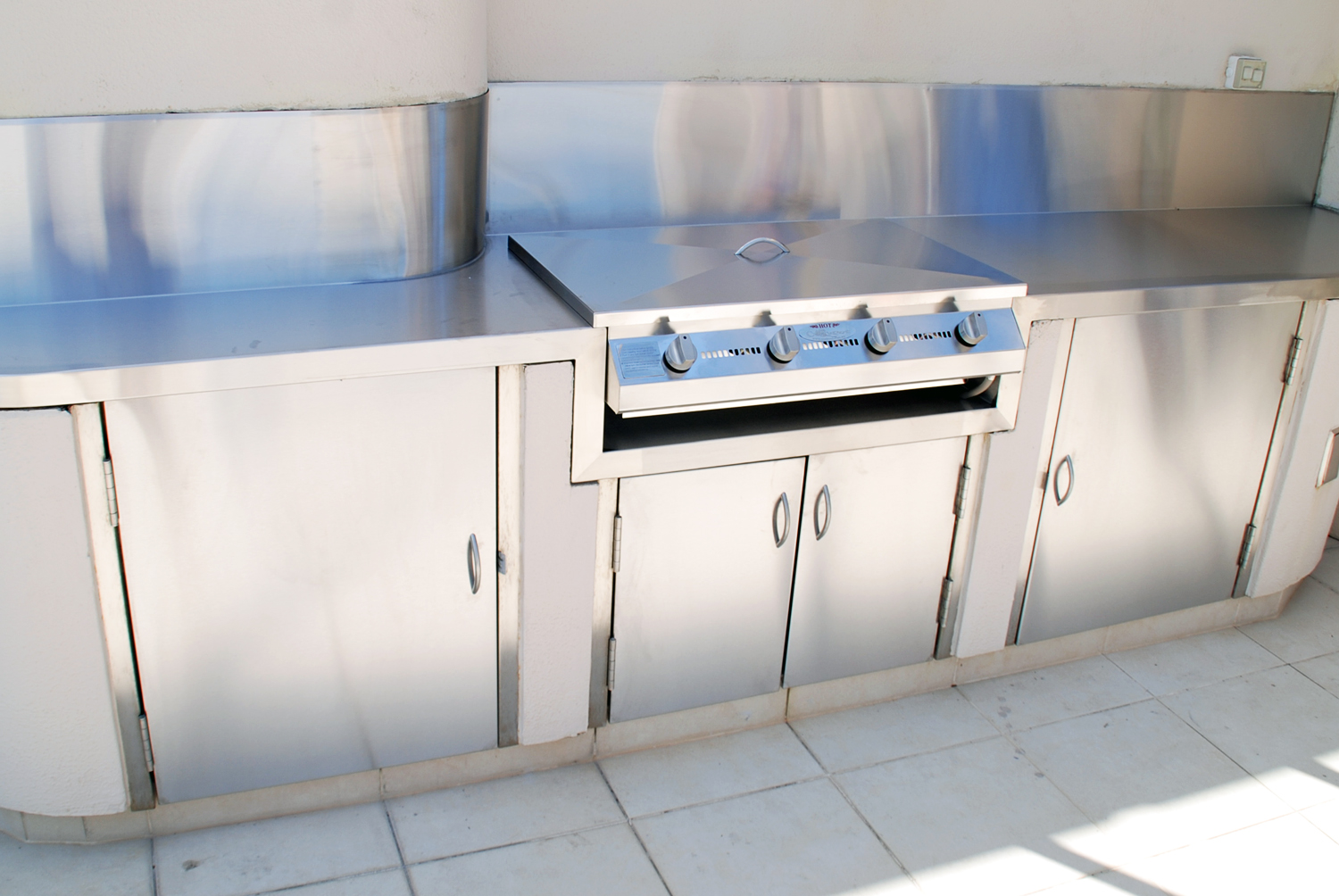 Residential stainless outdoor kitchen, benches and bbq