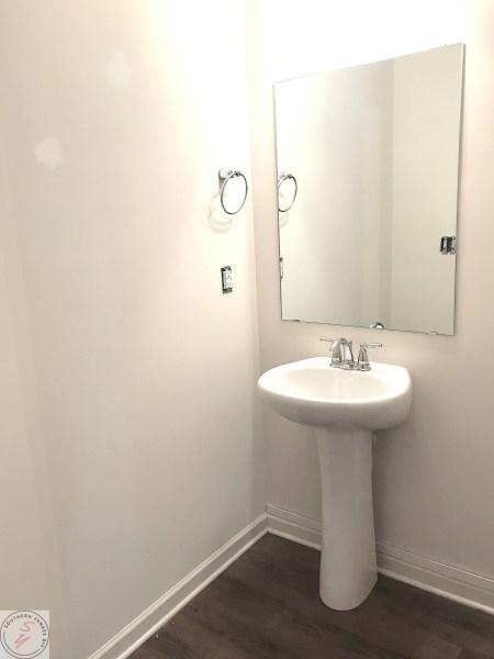 half bathroom sink, mirror, board & batten