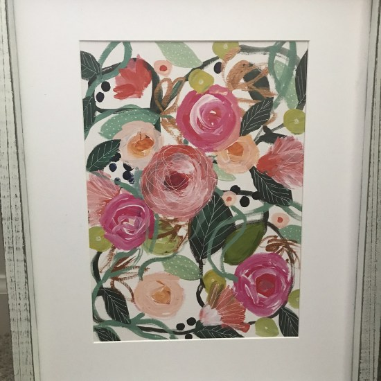 White Framed photo of different colored flowers