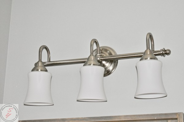 bathroom light, 3 light, silver light holder with white glass shades. modern farmhouse