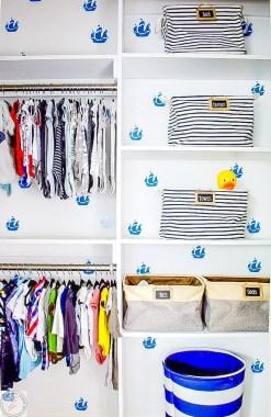 nursery closet, organization, built ins, bookcases, custom closet, nursery closet organization, faux wallpaper, kids closet, kids organization, diy built in closet, diy custom closet, cheap closet organization, amazon, closet bins, closet shelving, diy shelving, cheap shelving, easy shelving, easy closet organization, easy custom closet, easy built ins, kids room, nursery, gender neutral nursery, faux wallpaper diy, boat themed nursery, nautical theme, nautical themed nursery,