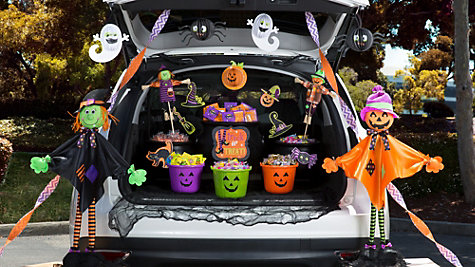 a car trunk with halloween decor and treats