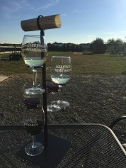 The Classic Flight at Heritage Vineyard in Mullica Hill, N.J., offers 5 wines such as 2014 Sauvignon Blanc, Cuvee Blanc – 5th Edition, Cuvee Rouge – 3rd Edition, 2012 Merlot, 2013 Chambourcin. At Heritage Vineyard you are able to enjoy a flight outside while enjoying the vineyard scenery. (Photo/Amanda Dean)