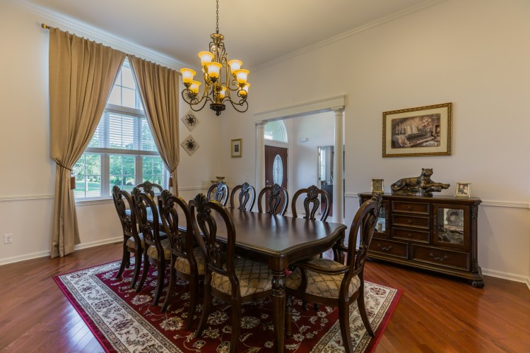 The Formal Dining with hardwood floors