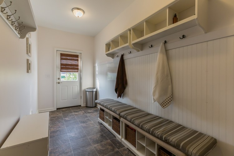 The mudroom leads out to the backyard Oasis