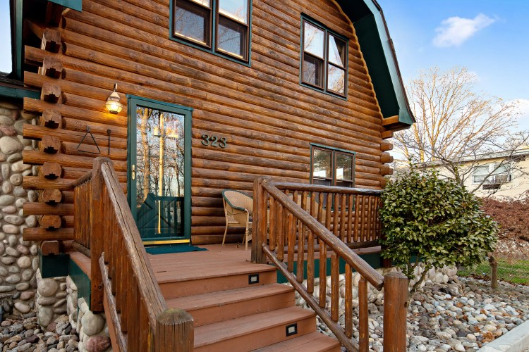The front deck of the log cabin.