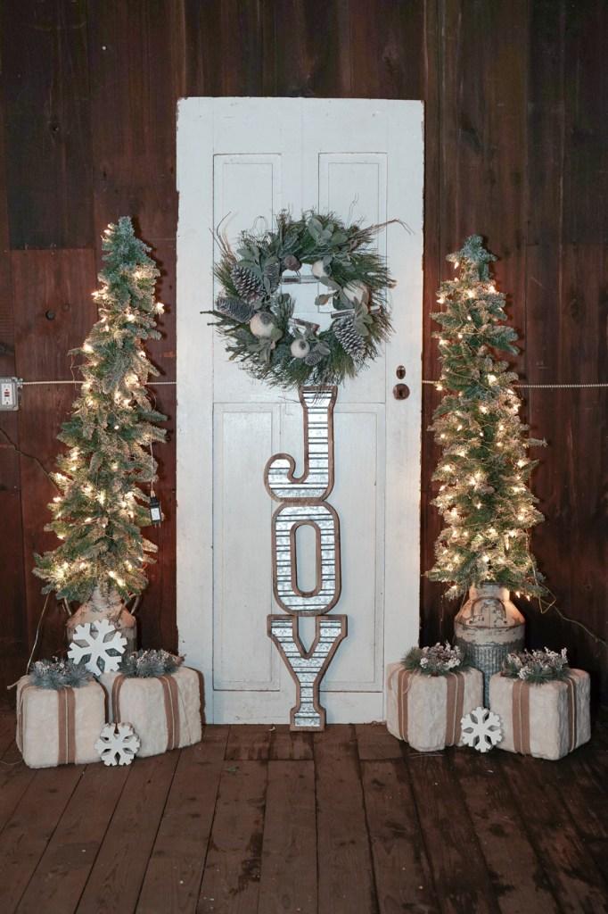 Barn door with wreath and joy on the door