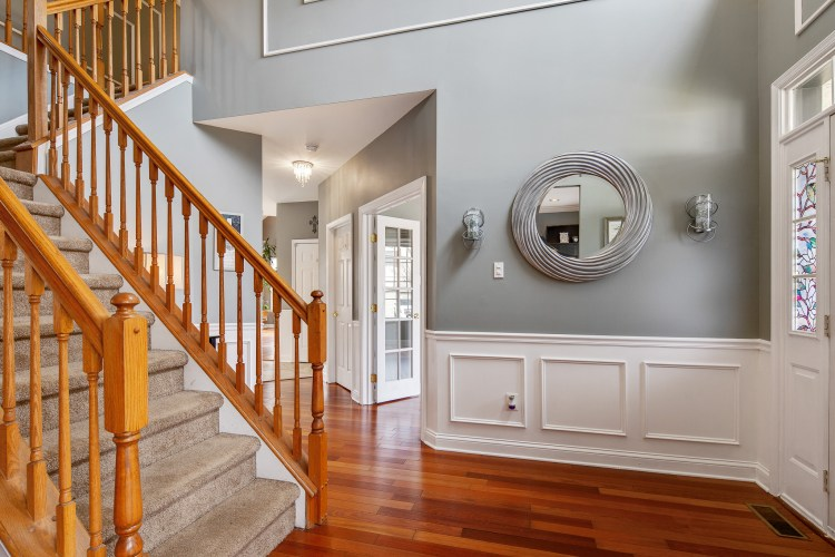 The two-story foyer with gorgeous hardwood floors and upscale trim work.