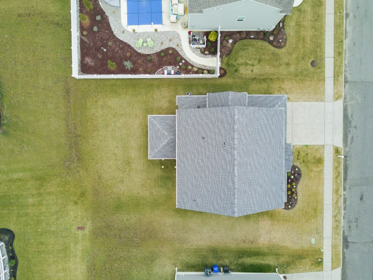 Aerial view of the home and yard