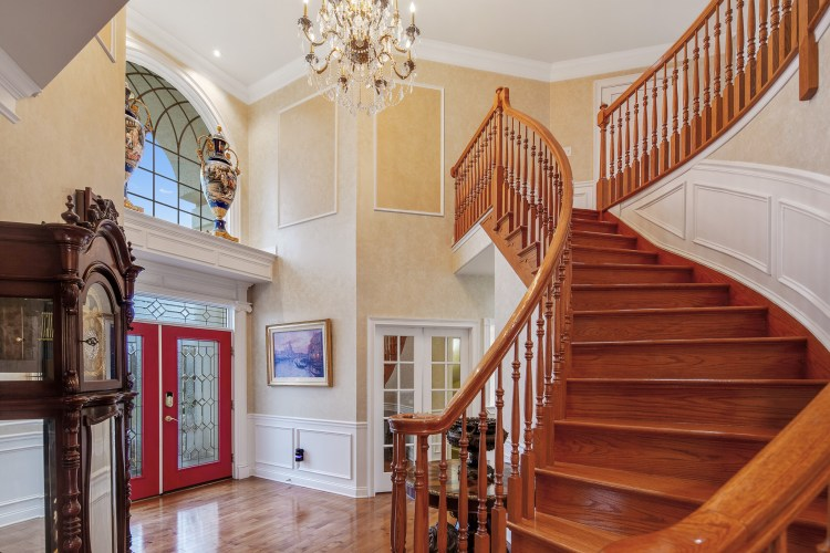 The foyer with grand oak staircase.