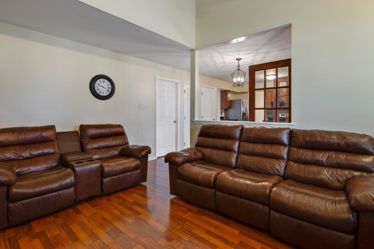 Family room with Vaulted Ceilings and fireplace with mantle 49 Woodduck Drive