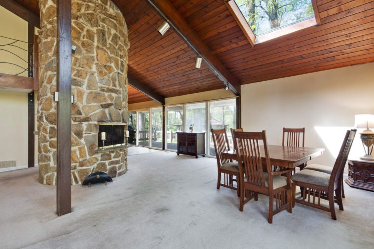 Dining room has a stone fireplace and skylight 15 Springhill road