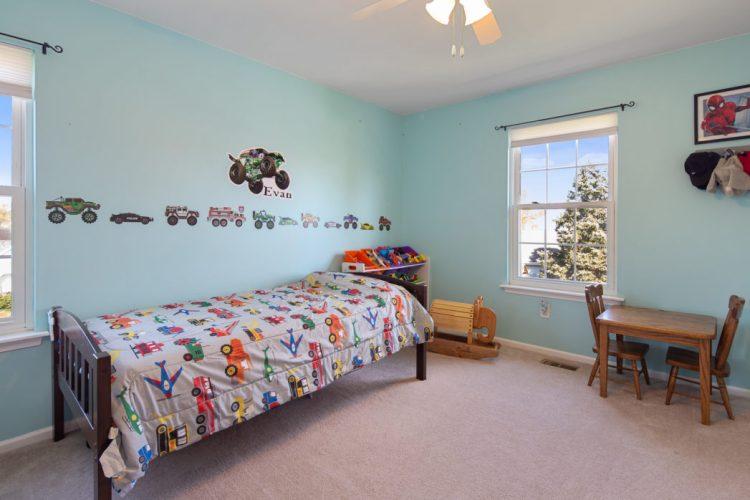 A sea foam colored bedroom
