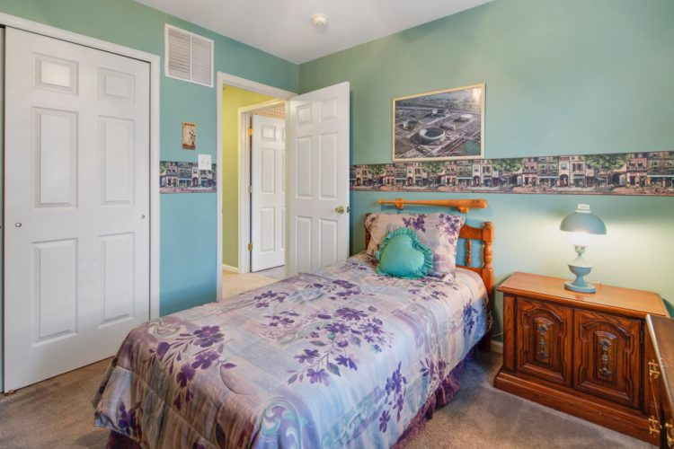 bedroom with light green paint