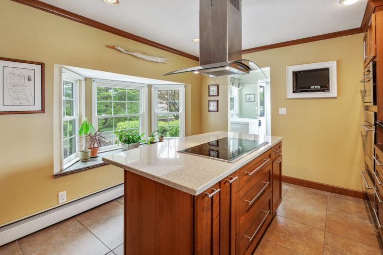 Kitchen at 397 Ferrell road has center island stove top and hood