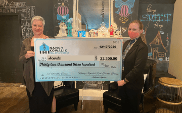 Small and mighty The Acenda donation check