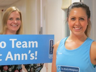 St Ann's Hospice fundraiser Hannah Saunders limbering up encouraged by colleague Carrie Bradshaw