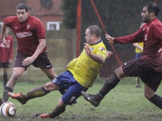 Action from South Manchester v Rochdalians (South in red)