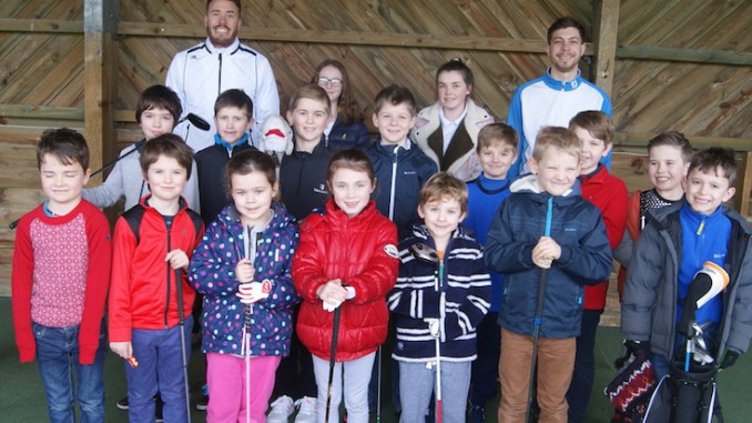 A group of youngsters with coaches Danny and Alex Mattison
