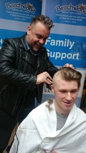 Lee Boardman cuts Harry Elmore's hair