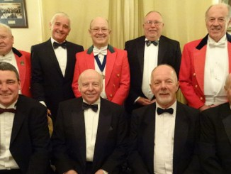 The top table at the Reddish Vale Golf Club dinner including in red jackets Colin Shadbolt (left), Tony Draper (centre) and Roy Smethurst (right) with Reddish Vale officials