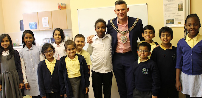 Cllr Carl Austin-Behan with school councillors at Crowcroft Park Primary School in Longsight