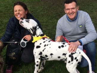 Chelsea Norris and Phil Trow with their dogs