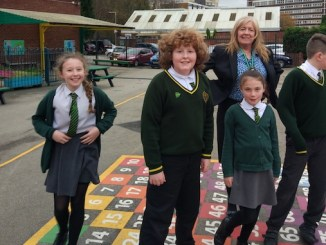 Pupils at St Joseph's and their new playground