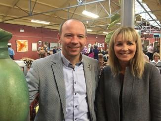 Nikki Baker with auctioneer Adam Partridge