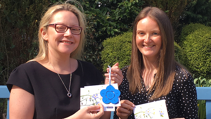 Louise Kelly and Sophie Reacroft with forget-me-nots