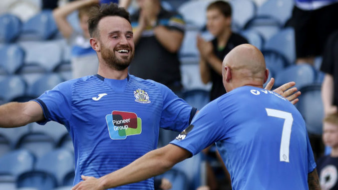 Stockport County celebrate Matty Warburton's goal (pic by Mike Petch)