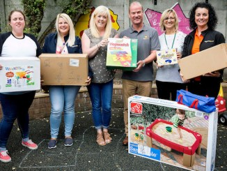 Staff from Stockport Without Abuse staff with their Amazon donation