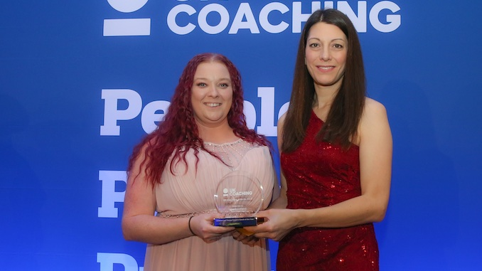 Sasha Moore receives her award from Katie Oman from Sports Scotland