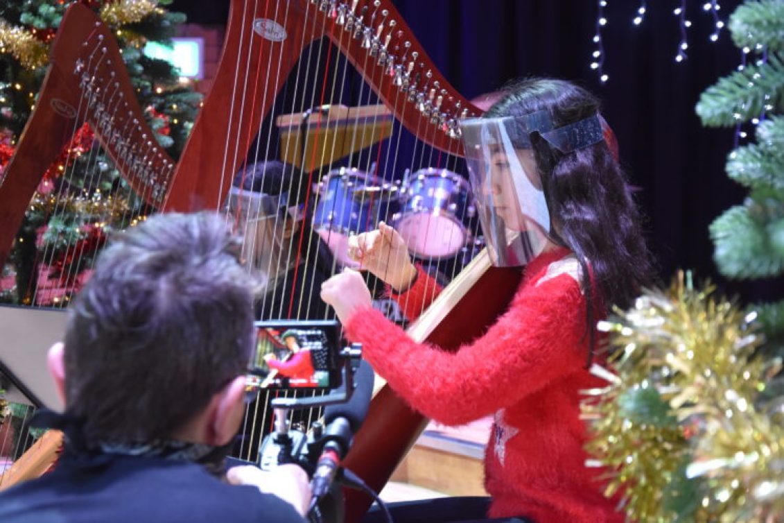 Covid-secure performance by Withington's harpists