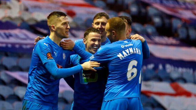 John Rooney scores for Stockport