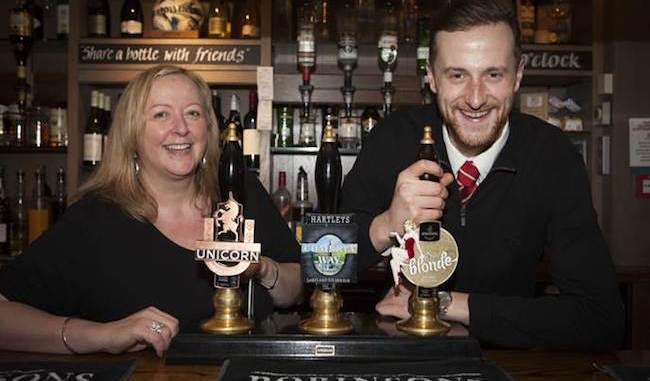 Davenport Arms landlady Yvonne Hallworth celebrates the pub's silver anniversary with son Jack