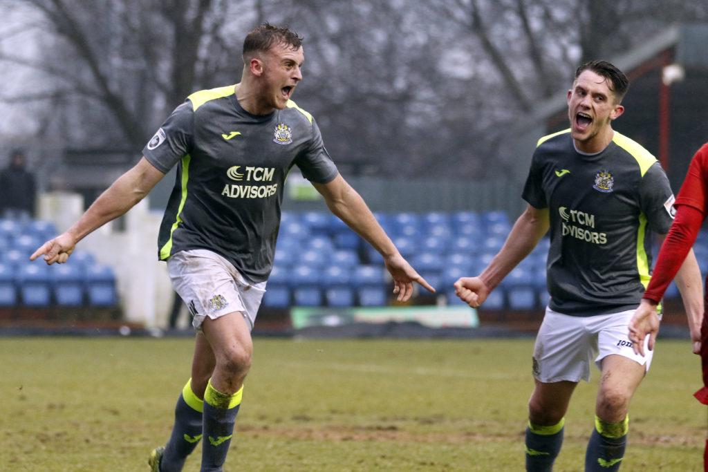 Josh Amis celebrates scoring County's opener at Alfreton