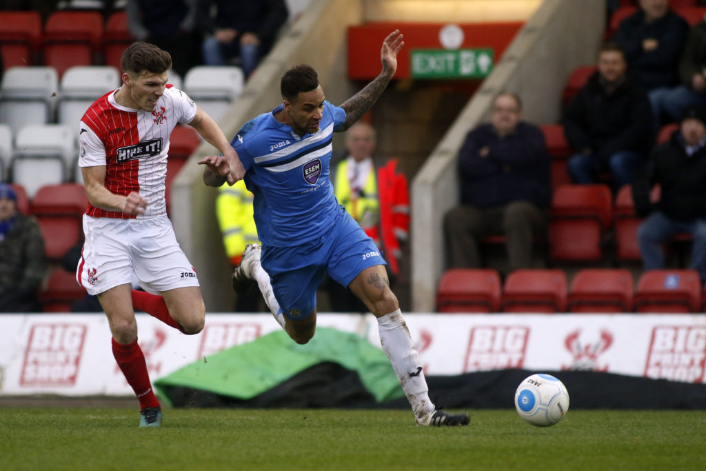 Sefton Gonzales challenges for the ball, for Stockport at Kidderminster