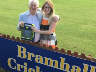 President of Bramhall Cricket Club, Professor Kevin Webb, with Andrea Airey from Cardiac Science
