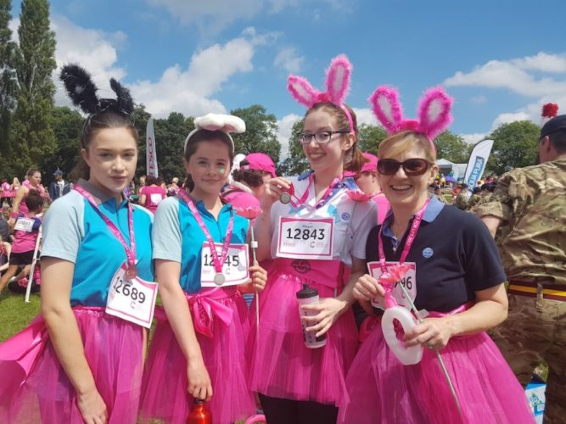 Urmston Rangers at Race for Life - Laura Samuel, 14, Katie Southern, 14, Megan Auld, 18, and Liz Southern