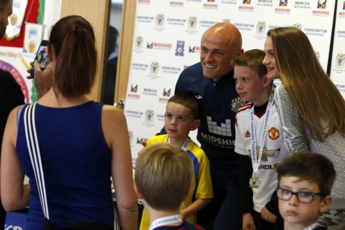 Stockport County's Sam Minihan poses for photos, during his work with the Community foundation