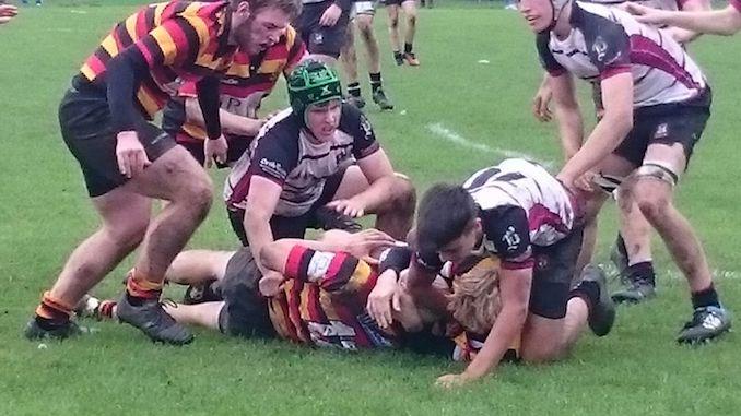 Declan McGeehan pounces at the breakdown for Heaton Moor