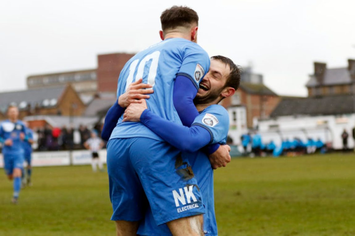 Matty Warburton celebrates his goal for Stockport with Adam Thomas