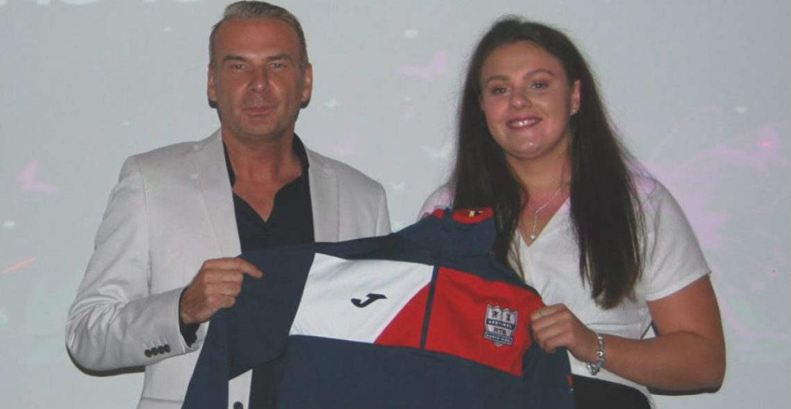 Life Leisure CEO Malcolm McPhail presents swimmer Holly Hibbott with her award