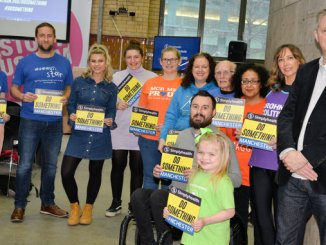 Poet Tony Walsh aka Longfella, with participants from the Simplyhealth Great Manchester Run