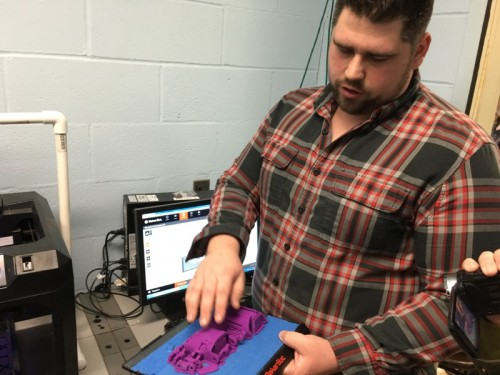 Michael Davies shows off parts for a prosthetic hand made by students with a 3D replicator in his technology lab at Greenport High SchoolPhoto: Denise Civiletti