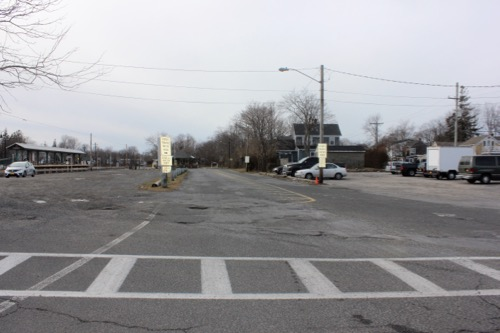 Most of the surfaces of the parking areas around the Greenport railroad station are in disrepair; two of them are unimproved and not in use. Photo: Denise Civiletti