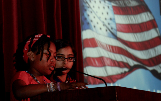 "Cayla Hardnett, grade five, read a poem she wrote called ""Our Flag."""