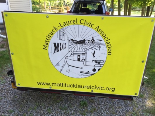 Harper hangs this banner on his trailer as the group collects litter to draw attention to their efforts. Courtesy photo.
