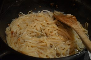After rice noodles is completely cooked. Add Chili paste and tamarind sauce.